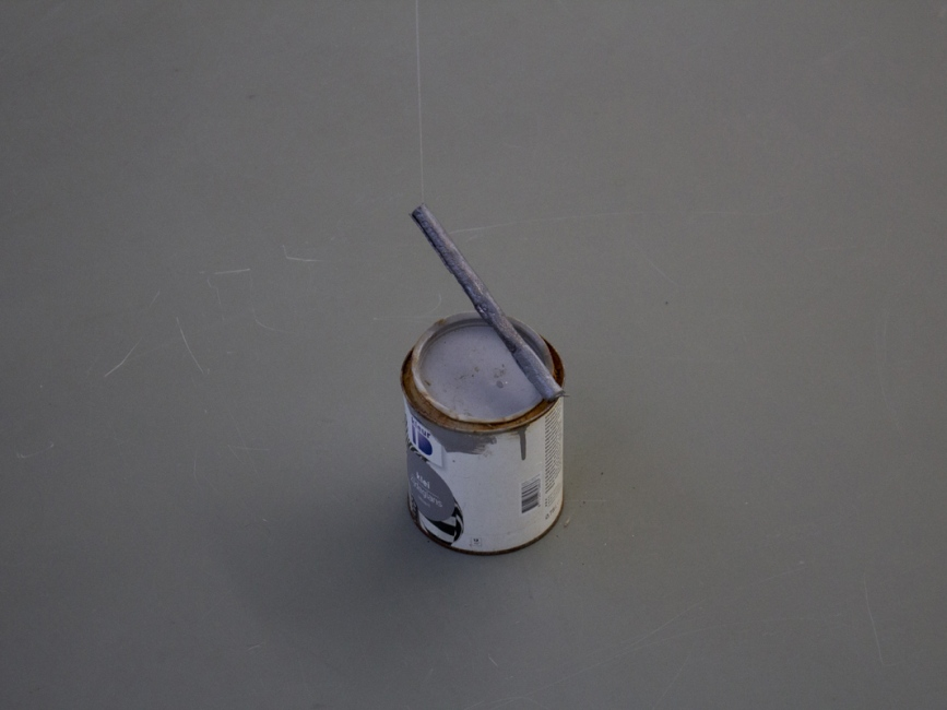 a tin of grey paint and a dancing grey stick